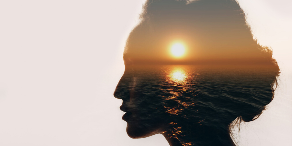 Image of womans head with a sunset. How to keep calm and grounded