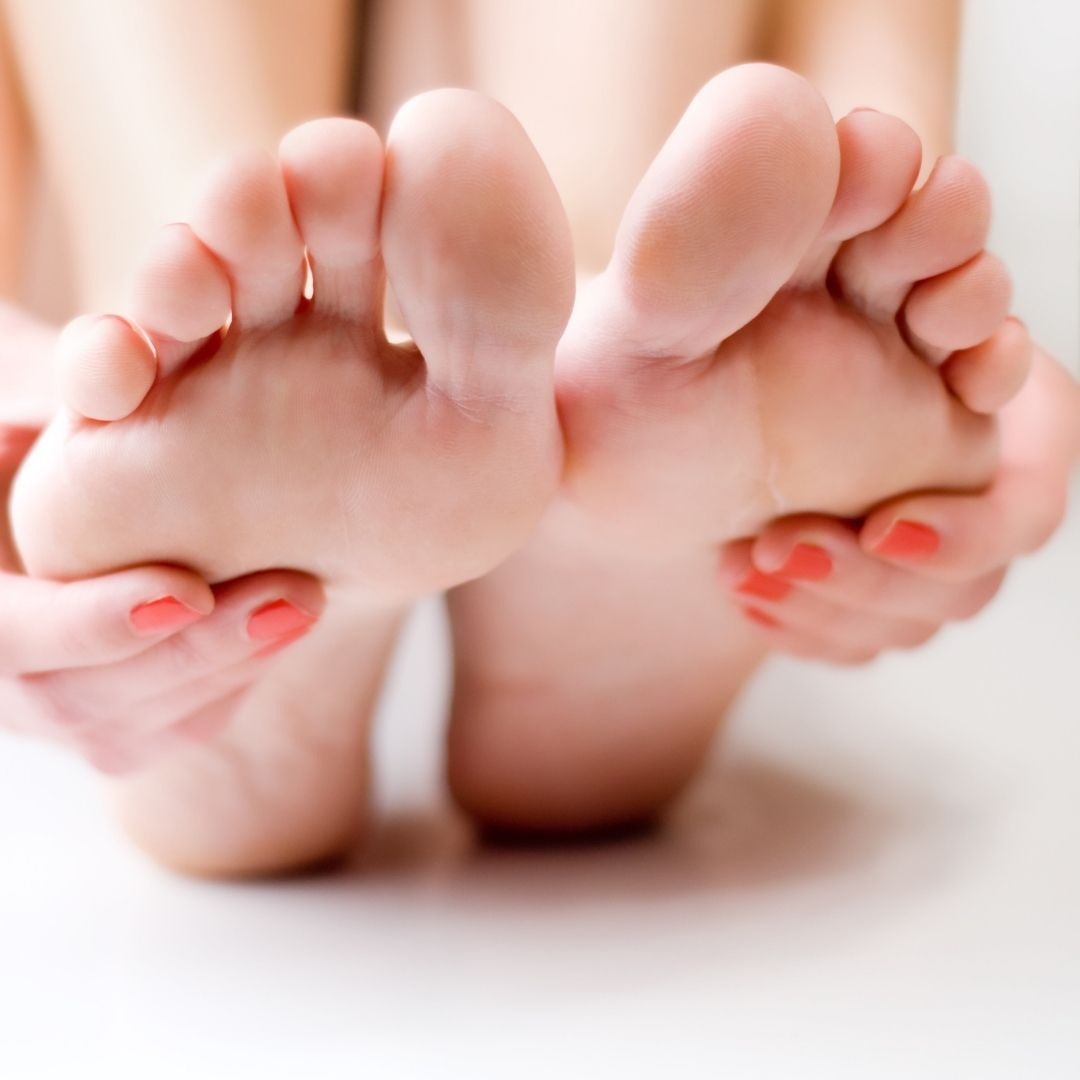 image of woman holding her own feet